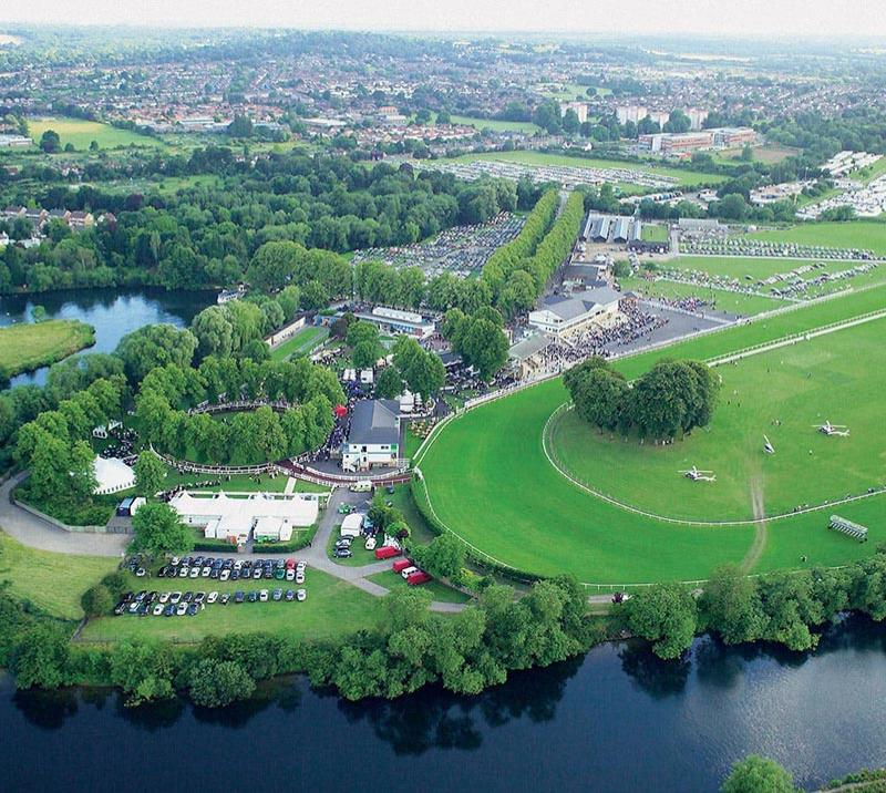 An overhead view of the greenery of Royal Windsor Racecourse.