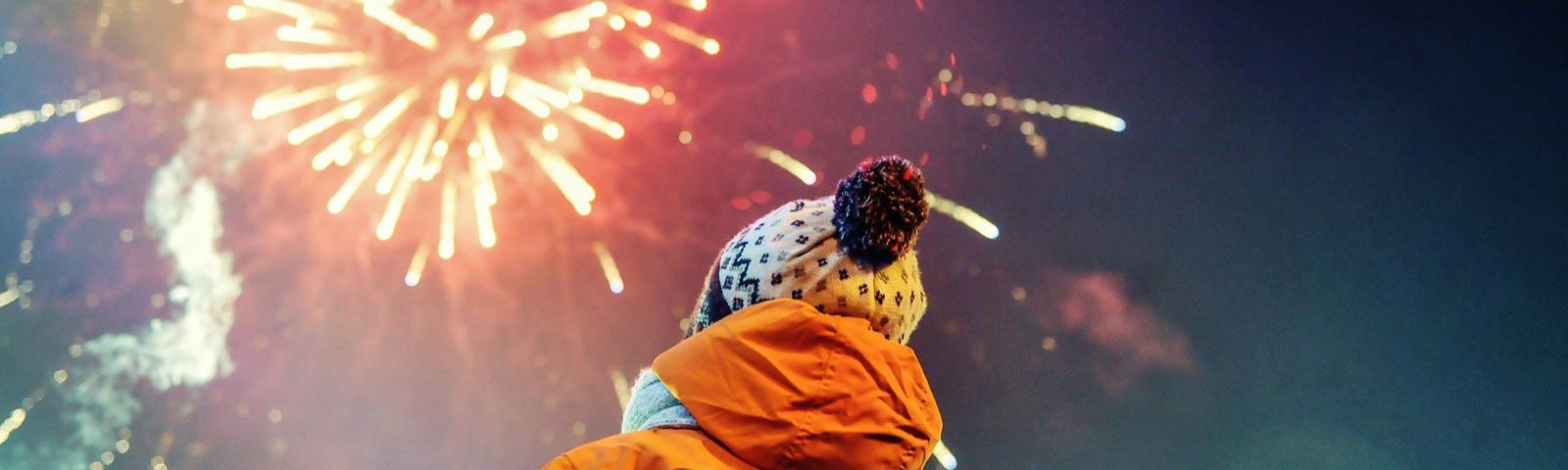 A child watching fireworks at Royal Windsor Racecourse